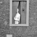 Woman in window B&W